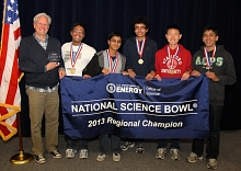 Photo - Group shot of students holding Science Bowl banner.