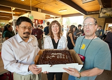 Su Dong and Tom Rizzo display a SLAC Summer Institute birthday cake