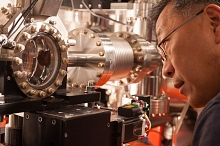 Yiping Feng examines a chamber at LCLS' Front End Enclosure