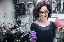 """Lawrence Berkeley Lab chemist Anna Llordés with a sample of """"smart"""" material for testing at SSRL Beam Line 11-3"""