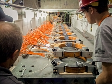 Photo - Researchers look over the magnetic coils that will impersonate the Earth's magnetic field.
