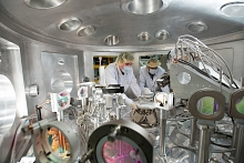 Image - Researchers prepare for an experiment in the Matter in Extreme Conditions station's chamber at SLAC's Linac Coherent Light Source X-ray laser. (SLAC National Accelerator Laboratory)