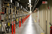 Image - SLAC's Klystron Gallery is a nearly 2-mile-long building that sits above the linear accelerator. The Klystron Gallery houses hundreds of klystrons that generate microwave pulses used as accelerating energy for the electron beam. (SLAC)