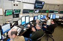 Image - Several members of the commissioning team work in the Main Control Center to turn on the LCLS laser (2009 photo). Paul Emma, center, led the effort to turn on the laser. (Brad Plummer)