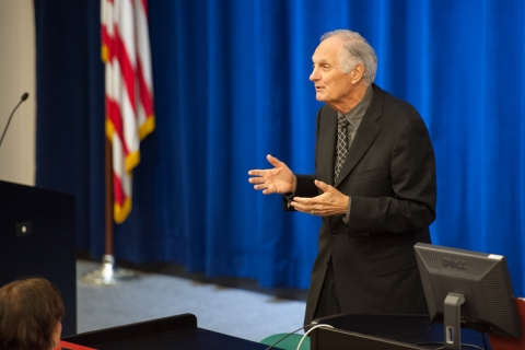 Photo - Alan Alda speaking in front of auditorium