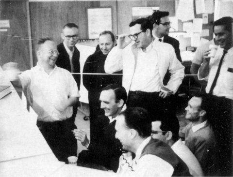 Photo - Archival photo of excited scientists in linac control room.