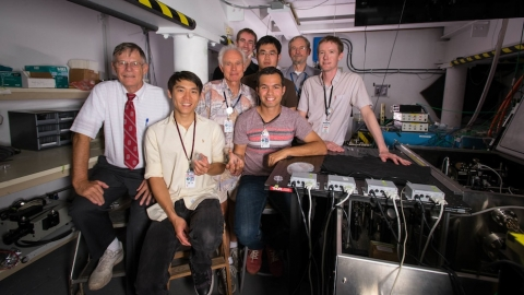 Many of the SLAC and Stanford researchers who helped create the accelerator on a chip are pictured in SLAC's NLCTA lab where the experiments took place. Left to right: Robert Byer, Ken Soong, Dieter Walz, Ken Leedle, Ziran Wu, Edgar Peralta, Jim Spencer a