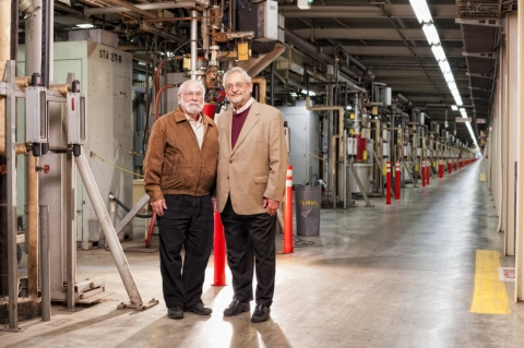 Image - SLAC scientist Herman Winick (left) and visiting scientist Claudio Pellegrini, in the accelerator klystron gallery in 2012. Winick and Pelligrini were instrumental in making the idea of the LCLS a reality. (Matt Beardsley)
