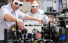 Photo - Two laser specialists wearing goggles, adjust...