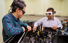 Yong Sing You and Shambhu Ghimire in the PULSE laser laboratory
